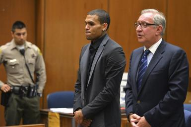Singer Chris Brown and attorney Mark Geragos (R)