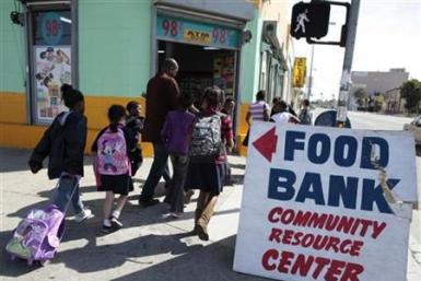 Regional coordinator Charles Evans (4th L) picks up children from school to take them to an after-school program at South Los Angeles Learning Center in Los Angeles, Californi