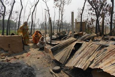 Hindu women in Bangladesh whose homes have been destroyed by Jamaat-e-Islami