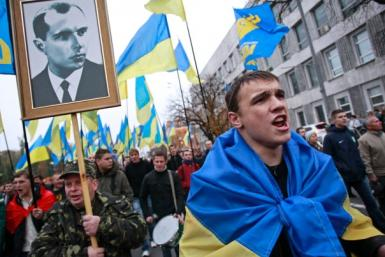 Activists of the Svoboda (Freedom) Ukrainian nationalist party shout slogans as they take part in a rally marking the 71st anniversary of the Ukrainian Insurgent Army (UPA)