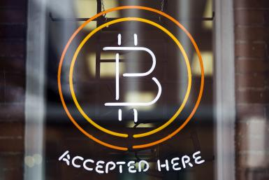 Bitcoin logo, digital cryptocurrency accepted by pro sports teams and  satellite networks