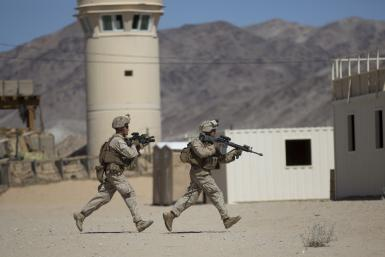Two U.S. Army soldiers run for cover during a live training exercise