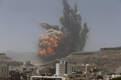 An explosion after a weapons depot is bombed in Sana'a, Yemen.