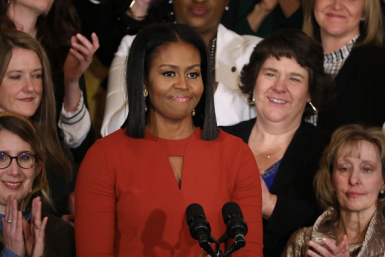 Michelle Obama surprisings young females students at school.