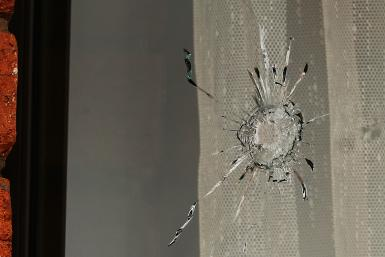 window gunshot hole