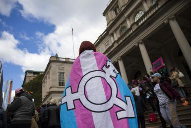 Activists wear transgender flag
