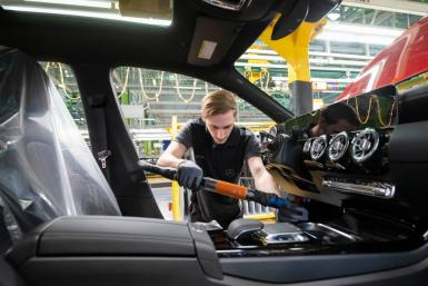 German working at the Daimler AG car factory