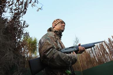 New Zealand duck hunter with gun