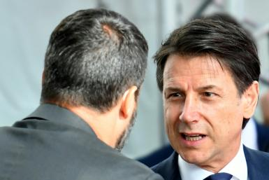 Italy's Prime Minister Giuseppe Conte (R) is expected to resign after far-right Interior Minister Matteo Salvini pulled the plug on a dysfunctional coalition