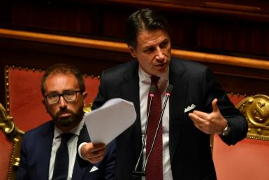 Italian Prime Minister Giuseppe Conte gestures as he delivers a speech at the Italian Senate, in Rome, on August 20, 2019, as the country faces a political crisis