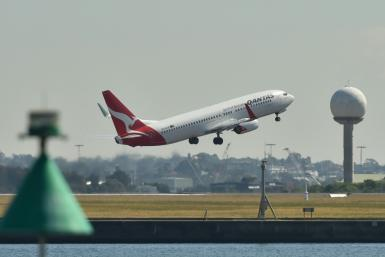 Qantas said the outlook for the airline was 'mixed', with weakness in the domestic tourism market and flat corporate travel demand