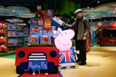 A man he selects a Peppa Pig toy at a store in Beijing