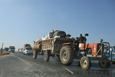 Syrian civilians flee government bombardment of their villages in the rebel-held Idlib region as troops advance on key towns along the strategic Damascus-Aleppo highway