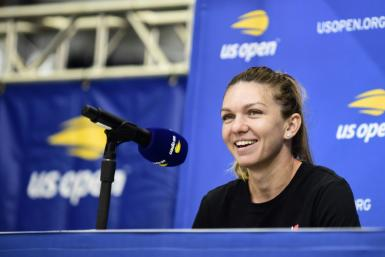 Reigning Wimbledon champion Simona Halep of Romania smiles during an interview session friday at the US Open