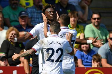 Chelsea striker Tammy Abraham celebrates with team-mates during their win at Norwich
