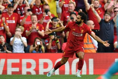 Liverpool's Mohamed Salah celebrates after scoring his second goal against Arsenal
