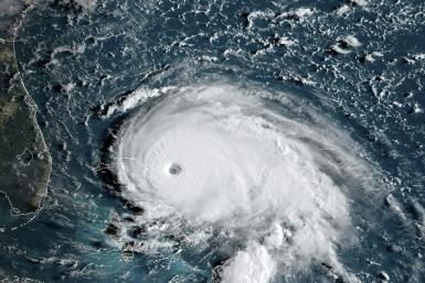 This satellite image obtained from NOAA/RAMMB, shows Tropical Storm Dorian as it approaches the Bahamas and Florida at 12:00 GMT on September 1, 2019