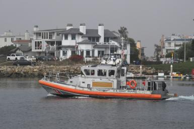 A Coast Guard crew leaves US Coast Guard Station Channel Islands in Oxnard, California, heading to the scene of a boat that burned and sank off Santa Cruz Island leaving more than 30 people missing and feared dead