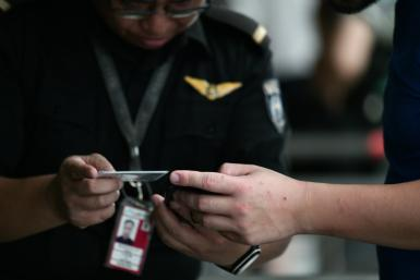 Security staff were carefully checking people's documents at the airport