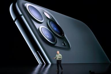 Apple senior vice president Phil Schiller unveils the triple-camera iPhone 11 Pro at a launch event at Apple's headquarters in Cupertino, California