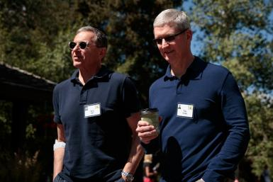 Bob Iger, left, chief executive officer of The Walt Disney Company, walks with Tim Cook, chief executive officer of Apple Inc., as they attend the Allen & Company Sun Valley Conference on July 6, 2016