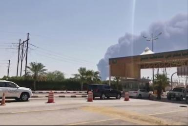 Smoke is seen billowing up from an Aramco oil facility in eastern Saudi Arabia after drone attacks claimed by Yemen's Huthi rebels sparked fires at two oil facilities