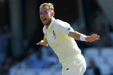 England's Stuart Broad celebrates after taking the wicket of Australia's David Warner on the fourth day of the fifth Ashes Test at the Oval