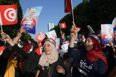 Supporters of Ennahdha candidate Abdelfattah Mourou attend an event on Thursday, as campaigning came to a close in Tunisia's presidential poll