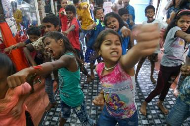 """At Baburao Ladsaheb's """"Five Star Acting Dancing Fighting Classes"""" in Mumbai's Dharavi, pupils learn the steps to famous Bollywood dances"""