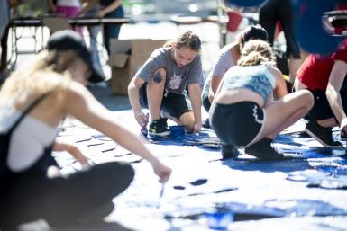 Nora Gell (center), 14, paints cardboard waves in Brooklyn on September 15, 2019 for the climate strike protests planned for September 20