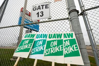 United Auto Workers (UAW) strike signs are at a gate at the General Motors Flint Assembly Plant after the UAW declared a national strike against GM at midnight on September 16, 2019 in Flint, Michigan