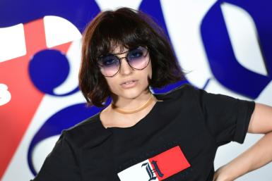 As the fashion world looks to go green, Italian influencer Federica Messaggeri poses during the presentation of the 'Tommy X Lewis' collection, a collaboration between US designer Tommy Hilfiger and British Formula One driver Lewis Hamilton
