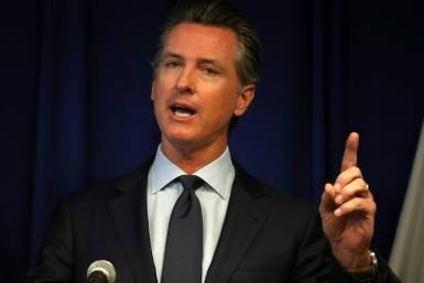 "California Gov. Gavin Newsom said a law he signed requiring rideshare firms to treat drivers as employees would be a step toward ""creating lasting economic security"""