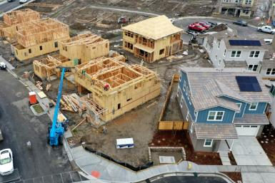(FILES) In this file photo taken on January 31, an aerial view of homes under construction at a housing development in Petaluma, California. Sales of new US homes declined in July, while home prices rose and the inventory of available homes climbed slight