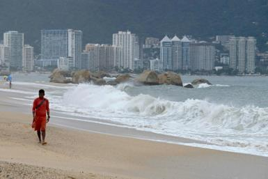 A lifeguard walks along the beach in Acapulco, Mexico on September 18, ahead of Lorena's expected arrival