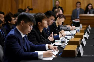 Prominent activist Joshua Wong (L) and Cantopop star Denise Ho (C) testified before a congressional commission about the pro-democracy movement in Hong Kong