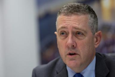 "James Bullard, president and CEO of the Federal Reserve Bank of St. Louis, voted for a bigger interest rate on September 18 cut to ""provide insurance"" against a slowing economy"