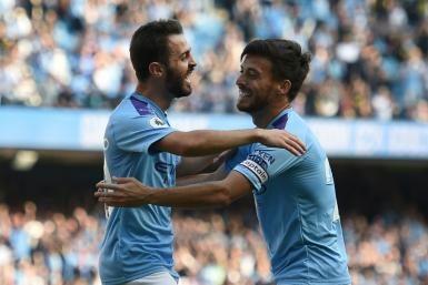 Manchester City's Bernardo Silva (L) celebrates with David Silva during their thrashing of Watford