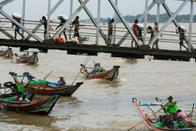 People from Dala township arrive in Yangon by boat after crossing the river