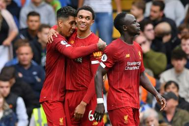 Roberto Firmino (left) and Trent Alexander-Arnold (centre) scored in Liverpool's 2-1 win at Chelsea