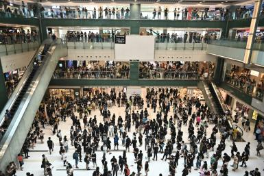 Protestors held flashmob gatherings in shopping malls across Hong Kong