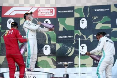 With the win at Suzuka by Valtteri Bottas (C) and third place by Lewis Hamilton (R) Mercedes clinched an unprecedented sixth successive world championship double of drivers and constructors titles