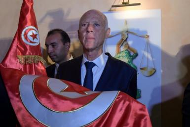 Official results in Tunisia's presidential election set to be released Monday are expected to seal a landslide victory for conservative political outsider Kais Saied