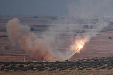 A missile fired by Turkish forces towards the Syrian town of Ras al-Ain, from the Turkish side of the border