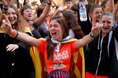 Around 25,000 students rallied in central Barcelona as they began a strike in protest over the verdicts
