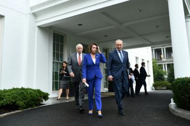 House Speaker Nancy Pelosi leads Senate Minority Leader Chuck Schumer and Representative Steny Hoyer, out of the White House after their fiery meeting with US President Donald Trump