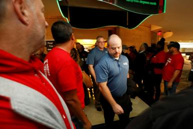 Members attending the UAW GM Council Meeting walk through a gauntlet of GM employees from the shuttered Lordstown Assembly as they arrive at the General Motors Renaissance Center in Detroit, Michigan, on October 17, 2019