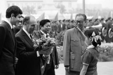Chinese Premier Zhao Ziyang (R) and a Chinese girl greet French President Francois Mitterrand on May 3, 1983 at Beijing's Tiananmen Square -- where troops six years later cracked down on democracy protests despite opposition from Zhao