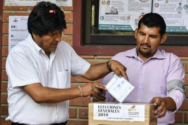 Bolivia's President Evo Morales (L) casts his vote in Chapare in the department of Cochabamba