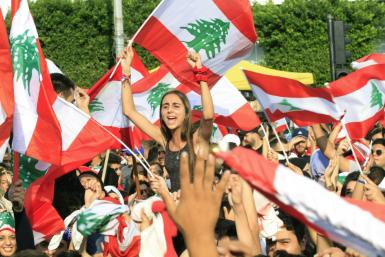Protests took place across Lebanon, with demonstrators waving Lebanese flags in the crowd in the southern city of Sidon